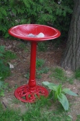 The bird bath was revitalized with a bit of bright red tremclad paint.